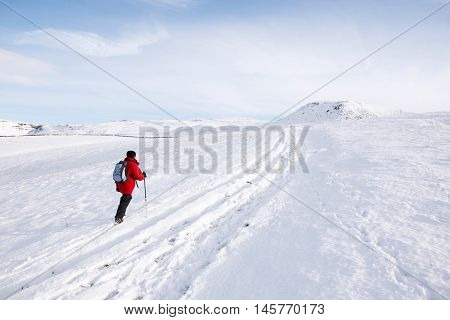 Woman Hiking In Snow