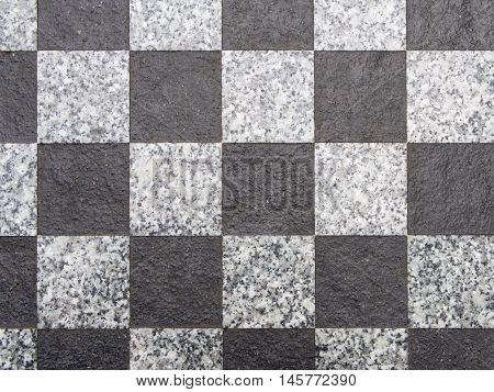 Black and white granite checkerboard pattern background texture