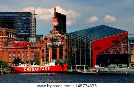 Baltimore Maryland - July 22 2013: The Lightship Chesapeake moored in front of the Power Plant commercial complex and the ultra-modern National Aquarium