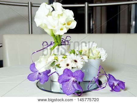 Flowers bouquet mix purple and white on the table in restaurant. Art composition.