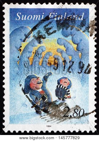 FINLAND - CIRCA 1994: a stamp printed in Finland shows Elves among Snow-covered Trees Christmas circa 1994