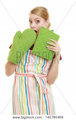 Young housewife in kitchen apron surprised emotional face expression wide eyes isolated on white background