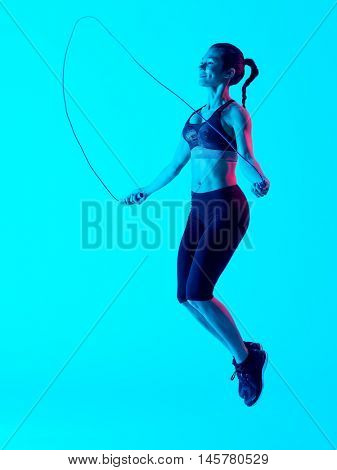 woman jumping rope  fitness exercices isolated