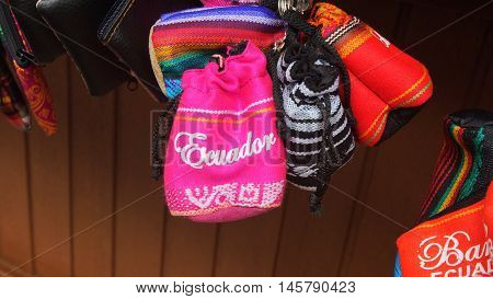 Banos de Agua Santa, Tungurahua / Ecuador - September 2 2016: Indian handmade bag sale at a craft store in the Pasaje Artesanal in the downtown of the city of Banos