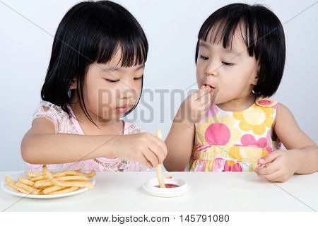Asian Chinese Little Girl Eating French Fries