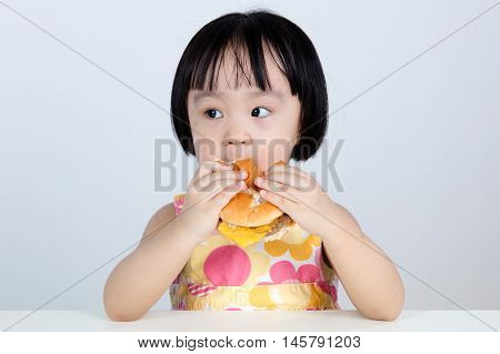 Asian Chinese Little Girl Eating Burger