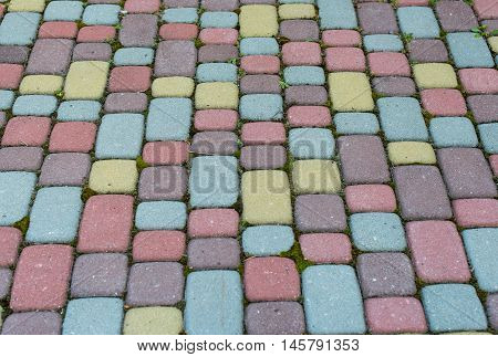 background of colored paving slabs mosaic construction