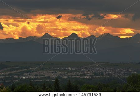 Golden skies and mountain backdrop against suburban neighborghoods