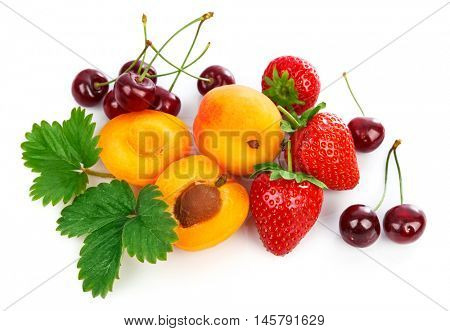 Mix fruits healthy eating berries apricot strawberries cherry with green leaves. Isolated on white background