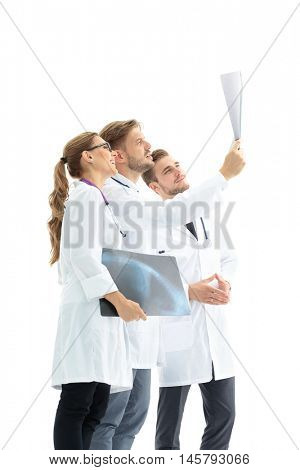 A group of doctors examining an x-ray in the hospital