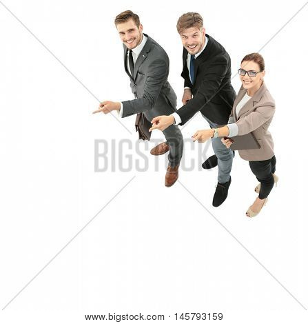 Happy smiling young business people pointing at wall