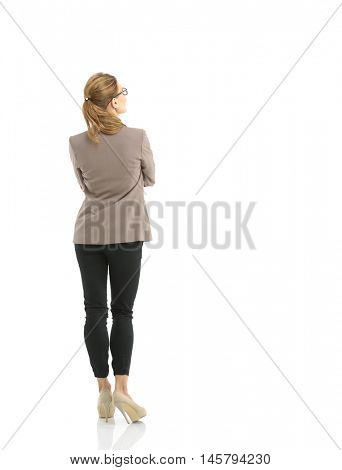 Full-length back side of businesswoman, isolated on white.