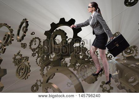 Woman businessman climbing cogwheels