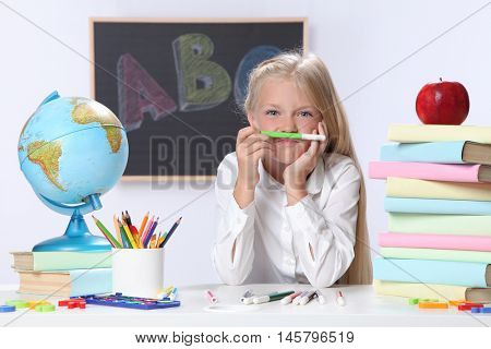 Portrait of cute girl in classroom