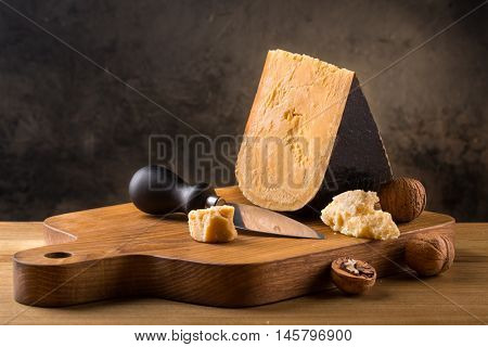 Still life with cheese on wooden board