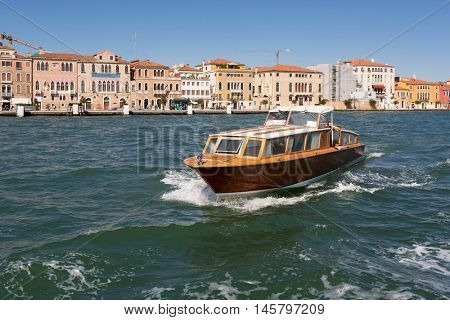 landscape of Venice, Italy. Sailing boat in the water