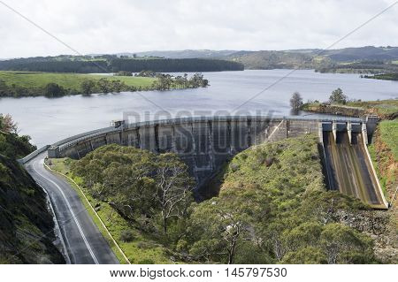 Concrete arch dam with ski-jump spillway of the Myponga Reservoir in Myponga South Australia