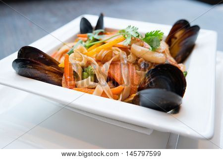 Sea food noodles in a white plate