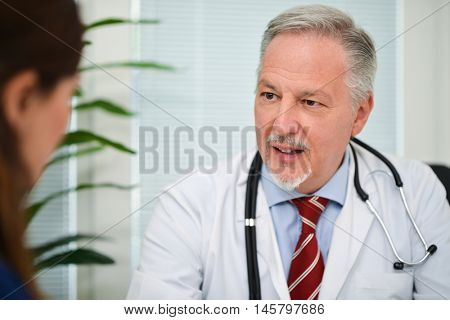 Doctor talking to her patient during a visit