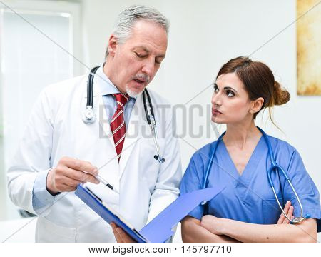 Doctor talking to a nurse