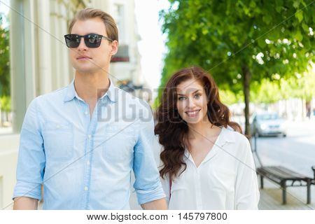 Happy couple having a walk in a city center