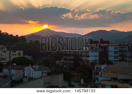 Sunrise over the mountain in the town of Tossa de Mar, Spain