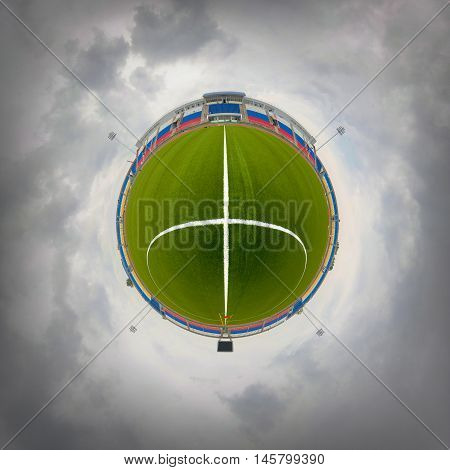 Soccer field. Cloudy weather. Panorama like a little planet