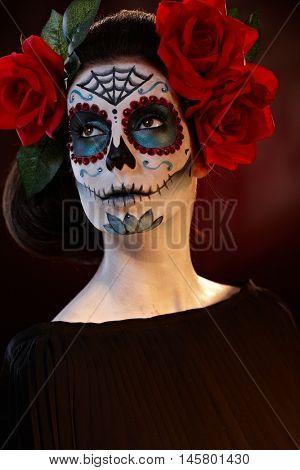 Portrait of woman in halloween mask.
