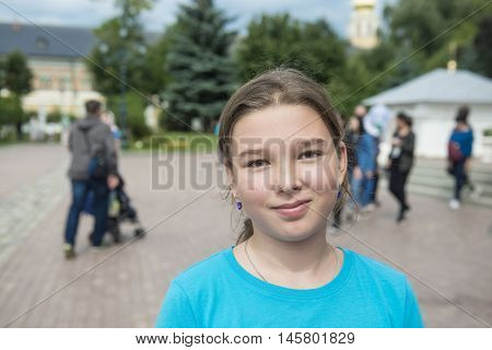 Happy teenage girl in the town square