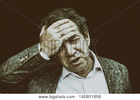 Portrait of a mature business man with headache