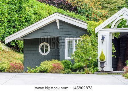 Fragment of a very neat and colorful home with gorgeous outdoor landscape in suburbs of Vancouver, Canada