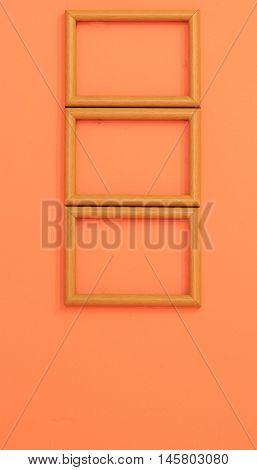Wooden Frame On Orange Vintage Wall