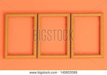 Wooden Frame On Orange Vintage Wall