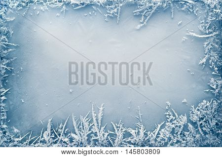 Frost crystal border on ice - Christmas background