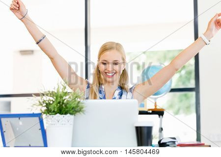 Happy young woman in office