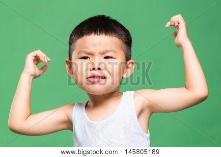 Asian little boy raising up hand