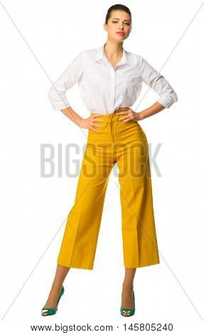 Young girl in yellow pants isolated