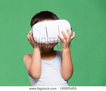 Asian little boy experience though VR device