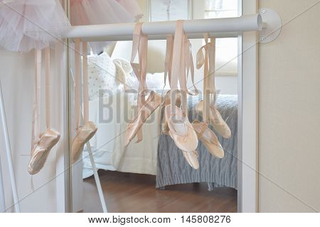 Ballet Shoes Hang On Bar In Bedroom