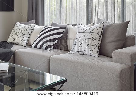 Light Gray Sofa With Varies Pattern Pillows In Modern Living Corner