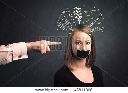 Caucasian hand pointing at scared female employee