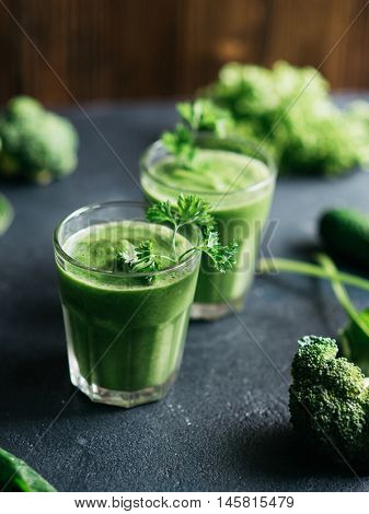 Healthy green smoothie with spinach, kale and cucumber in glass. Detox, diet or healthy food concept