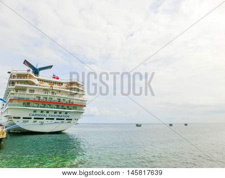 Saint Kitts Federation of Saint Kitts and Nevis - May 13 2016: The Carnival Cruise Ship Fascination at dock. She is one of 8 sister ships and received a million dollar refurbishment in 2006