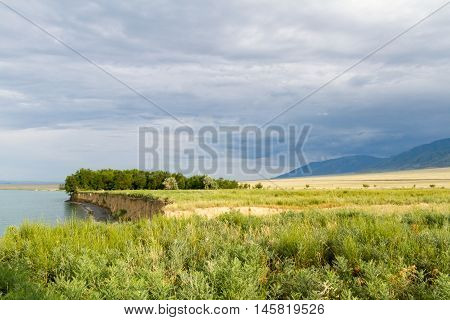 Lake, Steppe And Mountains