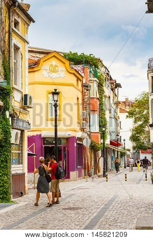 Plovdiv, Bulgaria - September 3, 2016: City center street with houses and people