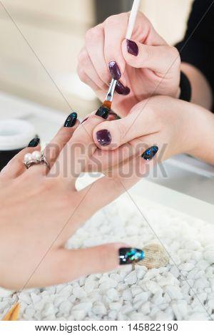Fingernail design in nail salon, color image