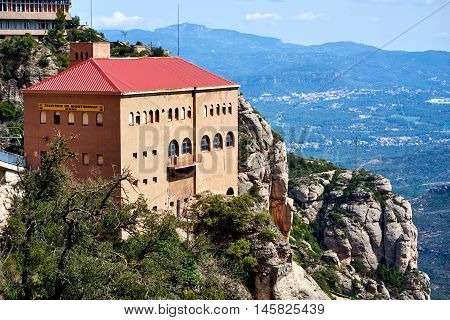 Montserrat Spain - April 6 2016: The Aeri de Montserrat is an aerial cable car which provides one of the means of access to the Montserrat mountain and abbey. Spain