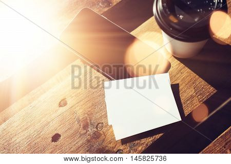 Blank White Business Card Mockup.Smartphone High Textured Wood Table Take Away Coffee Cup Cafe.Work Modern Office Blurred Background.Clean Object Private Corporate Information Horizontal Mock Up Flare