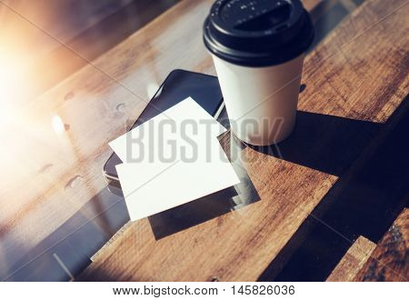 Two Blank White Business Card Mockup Wood Table Take Away Coffee Cup Coworking.Modern Phone Ready Work Office Sunlight Background.Clean Object Private Corporate Info.Horizontal Hot Drinks Mock Up