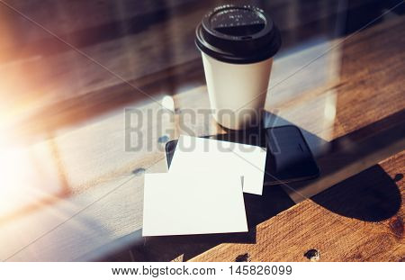 Two Blank White Business Card Mockup Wood Table Take Away Coffee Cup Coworking.Modern Phone Ready Work Office Glass Background.Clean Object Private Corporate Info.Horizontal Hot Beverages Mock Up